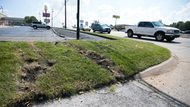 Tire tracks crossing a grassy median along Seiger Avenue and into the Andy's Frozen Custard parking lot are a remnant of an accident that left Kendrick Johnson dead after he was hit by a car driven by a teen driver early in the morning of Aug. 27, 2016, on East Sunshine Street. (News-Leader file photo)