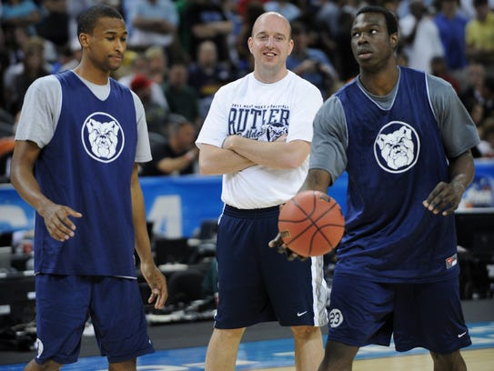 Matthew Graves (middle) was the associate head coach under Brad Stevens at Butler from 2010-13.
