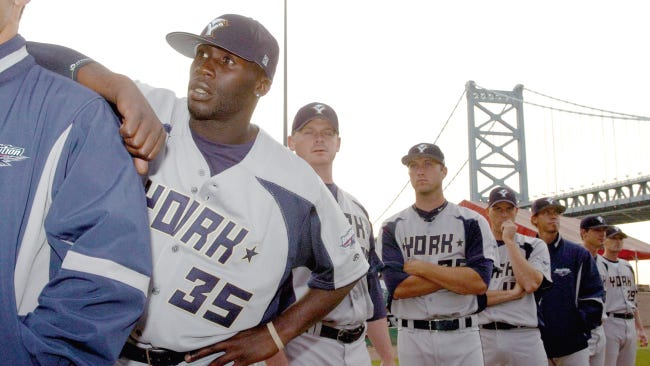 York Revolution pitcher Corey Thurman, left, waits to take the field before the 2008 season opener in Camden, N.J. It was the second season of the Revs' franchise and Thurman's first season with the team. He was released Monday as the Atlantic League approaches a June 1 deadline for teams to trim rosters to 25 players.