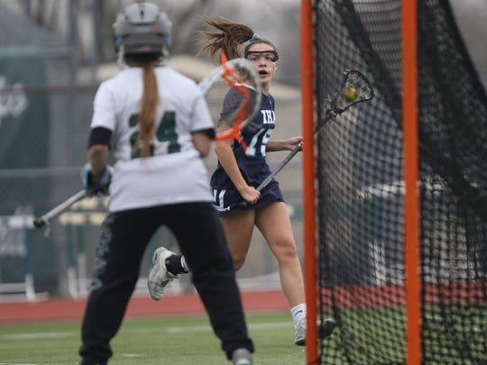 MaryPat Sayre, of IHA, eyes the goal at Ramapo, Thursday, April 12, 2018.  IHA won the game, 13-4.