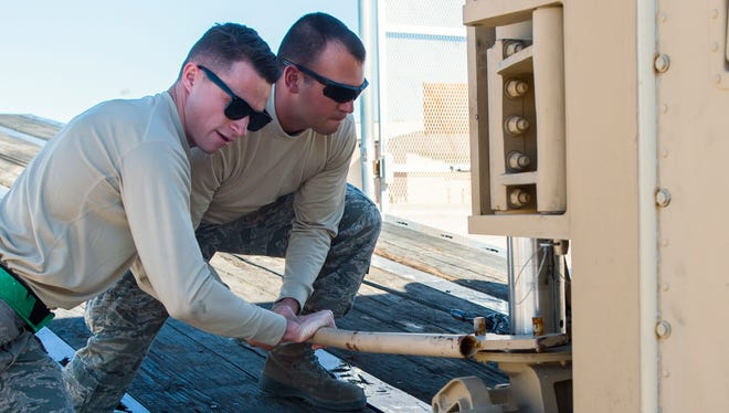 Senior Airman Tyler (left) and Senior Airman Justin (right), 49th Aircraft Maintenance Squadron aircraft communications maintenance technicians, unload a new Ground Control Station Nov. 14 at Holloman Air Force Base, N.M. The new GCS is the first of 15 new systems, and is scheduled to be fully installed and operational by April 2017 pending thorough inspections.