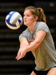 St. Cloud State's Erin Navratil returns a serve during
