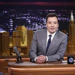 "In this Feb. 17, 2014 file photo provided by NBC, Jimmy Fallon appears during his ""The Tonight Show"" debut, in New York. Comcast's first-quarter net income rose by nearly a third as ad revenue surged at broadcast network NBC, helped by the Winter Olympics in Sochi and Fallon's elevation as host of ""The Tonight Show."""