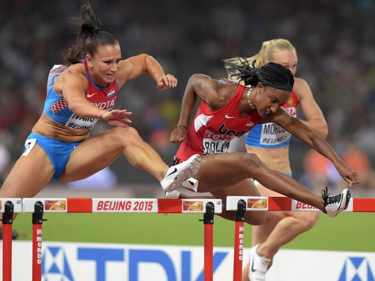 Aug 28, 2015; Beijing, China; Andrea Ivancevic (CRO) and Brianna Rollins (USA) run in a womens 100m hurdles semifinal during the IAAF World Championships in Athletics at National Stadium. Mandatory Credit: Kirby Lee-USA TODAY Sports