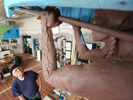 Skip Wallen takes a moment to examine his sculpting
