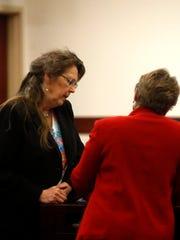 Deborah Davis, left, talks with defense attorney Liane