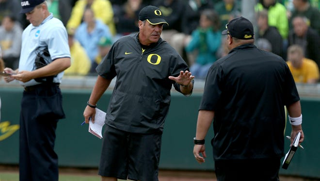 Oregon head coach Mike White, center, during their game with North Dakota State on Friday, May 15, 2015, in Eugene, Ore.