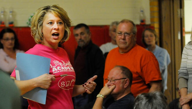 Amy Bonfig, owner of Little Saints Academy, lead a meeting on Wednesday at Wilson school. The former school, part of which is leased to Little Saints, might be sold to low-income housing developers.