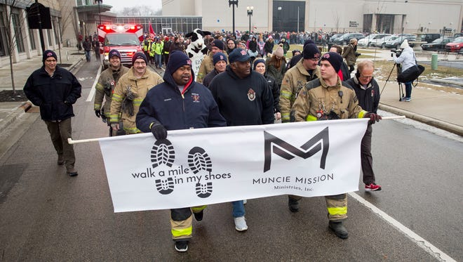 "Members of the Muncie Fire Department help lead the crowd on Feb. 10 for the Muncie Mission's ""Walk a Mile in my Shoes"" event. Over the years that the event has been run, the event has helped raise nearly nearly $800,000."