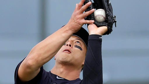 New York Yankees second baseman Rob Refsnyder catches a pop up by Miami Marlins' Jeff Mathis for an out during the sixth inning of an exhibition spring training baseball game Tuesday, March 8, 2016, in Jupiter, Fla. The Marlins won 1-0.