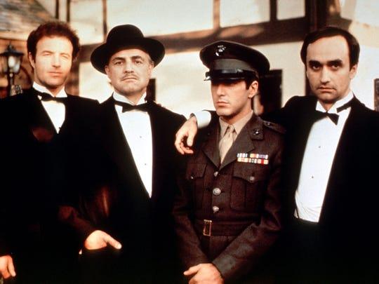 "It's the men of the Corleone family: Sonny (James Caan, from left), Don Vito (Marlon Brando), Michael (Al Pacino) and Fredo (John Cazale) in 1972's ""The Godfather."""