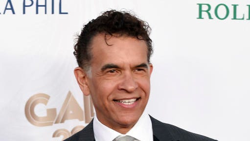 FILE - This Sept. 27, 2016 file photo shows Brian Stokes Mitchell at the Los Angeles Philharmonic's Walt Disney Concert Hall Opening Night Concert and Gala in Los Angeles.  Mitchell will join Betty Buckley, Jessie Mueller, Kelli O'Hara, Chita Rivera and Billy Porter on Inauguration Day at a concert in New York City that raises money for human rights organizations. It's intended to be the first in a series of monthly benefit concerts and will be streamed live on Facebook.