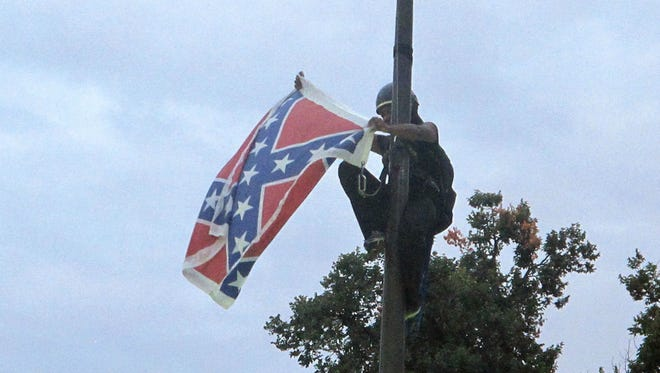 Bree Newsome removes the Confederate battle flag at S.C. Statehouse grounds on June 27, 2015.