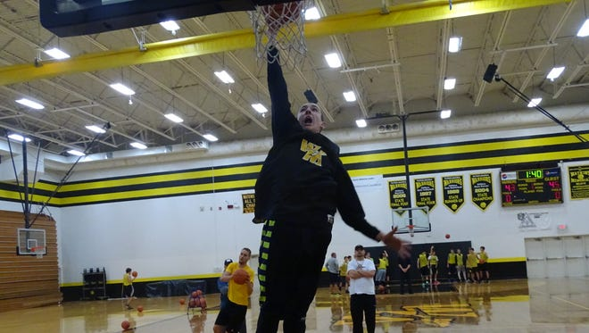 Watkins Memorial junior Ben Pack goes up for a dunk during a recent practice. The Warriors host Dublin Scioto on Friday to open the regular season.