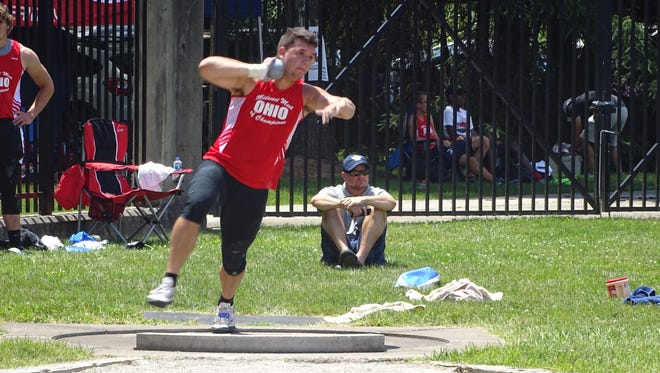 Lancaster graduate Nik Curtiss competes in the shot put Saturday during the Midwest Meet of Champions at Ohio Wesleyan. Curtiss placed second in the event.