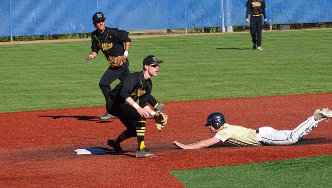 Watkins Memorial shortstop Zach Schone readies for the throw while Lancaster's Noah Dryden slides into second base and second baseman Jeremiah Cangelosi backs up the play during Monday's Division I district tournament game.