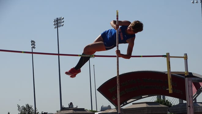 Zane Trace's Olivia Pflaumer attempts to clear the bar in the pole vault during the Division II state track meet Saturday at Jesse Owens Memorial Stadium.