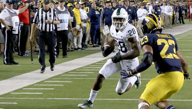 Michigan State RB Madre London heads into the end zone for MSU's second TD in the first half against Michigan at Michigan Stadium in Ann Arbor on Sat., Oct. 7, 2017.
