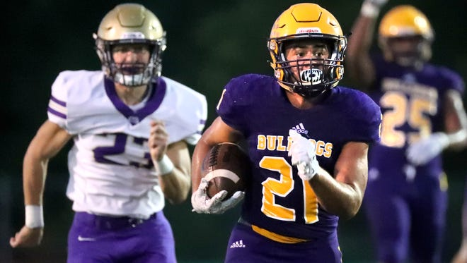 Smyrna's Blake Watkins (21) runs the ball  for a touchdown during the game against CPA at Smyrna High School on Friday, Aug. 31, 2018.
