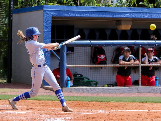 West Florida's Rachel Wright (14) hits the ball to