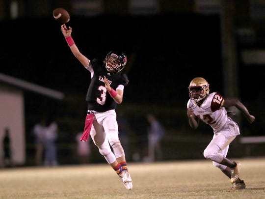 North Florida Christian's Trey Fisher throws the ball