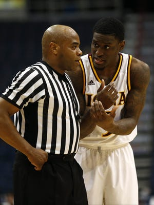A.J. English, shown here during last season's MAAC Tournament championship game, will lead Iona against Monmouth University on Friday night