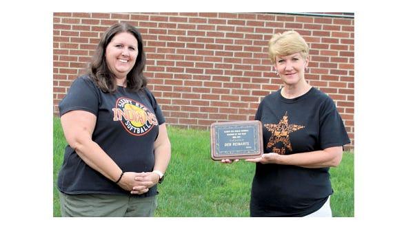 Sleepy Eye Education Association President Mindy Berkner (left)  presented Deb Reinarts with the Teacher of the Year award.