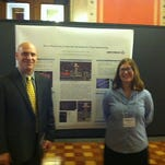 Rebecca Barrett, a senior from University of Iowa, recently presented to Representative Dave Jacoby about 3D-Bioprinting of artificial blood vessels for tissue engineering. Pictured, from left, are Representative Dave Jacoby and Rebecca Barrett.