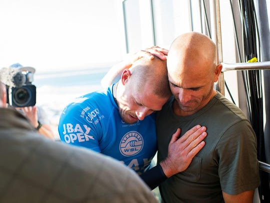 Australian surfer Mick Fanning (pictured blue) hugging Kelly Slater after being attacked by a shark during the J-Bay Open final in Jeffreys Bay, South Africa.
