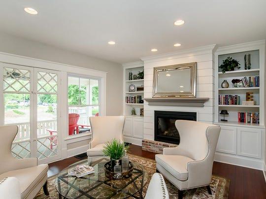 The living room retains the original fireplace.