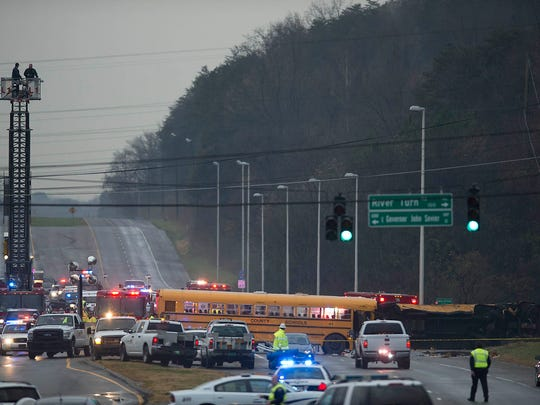 The scene of a crash of two school buses that killed two children and an adult aide is pictured Tuesday, Dec. 2, 2014, in East Knoxville. The crash, involving buses from Chilhowee Intermediate School and Sunnyview Primary School, happened at the intersection of Asheville Highway and Gov. John Sevier Highway.