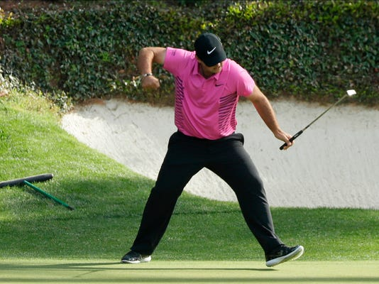 Patrick Reed reacts to his birdie on the 12th hole during the fourth round at the Masters golf tournament Sunday, April 8, 2018, in Augusta, Ga. (AP Photo/David J. Phillip)