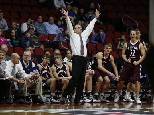 Western Christian boys basketball head coach Jim Eekhoff acknowledges the fans after leading his boys to a Class 2A state title against Cascade on March 11, 2016, at Wells Fargo Arena in Des Moines.