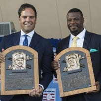 Hall of Fame inductees Mike Piazza, left, and Ken Griffey Jr. pose with their Hall of Fame plaques during Sunday's induction ceremony at Clark Sports Center in Cooperstown.