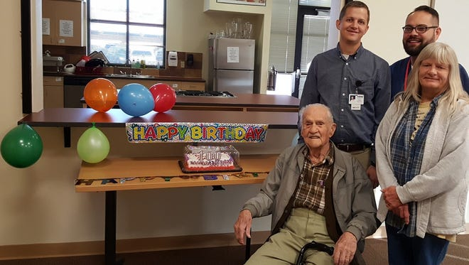 Arthur Veeder celebrated his 100th birthday at HMS. Above, Veeder poses with his caregiver Pat Shanks and HMS PA Clifton Rogers and MA Kevin Amador.