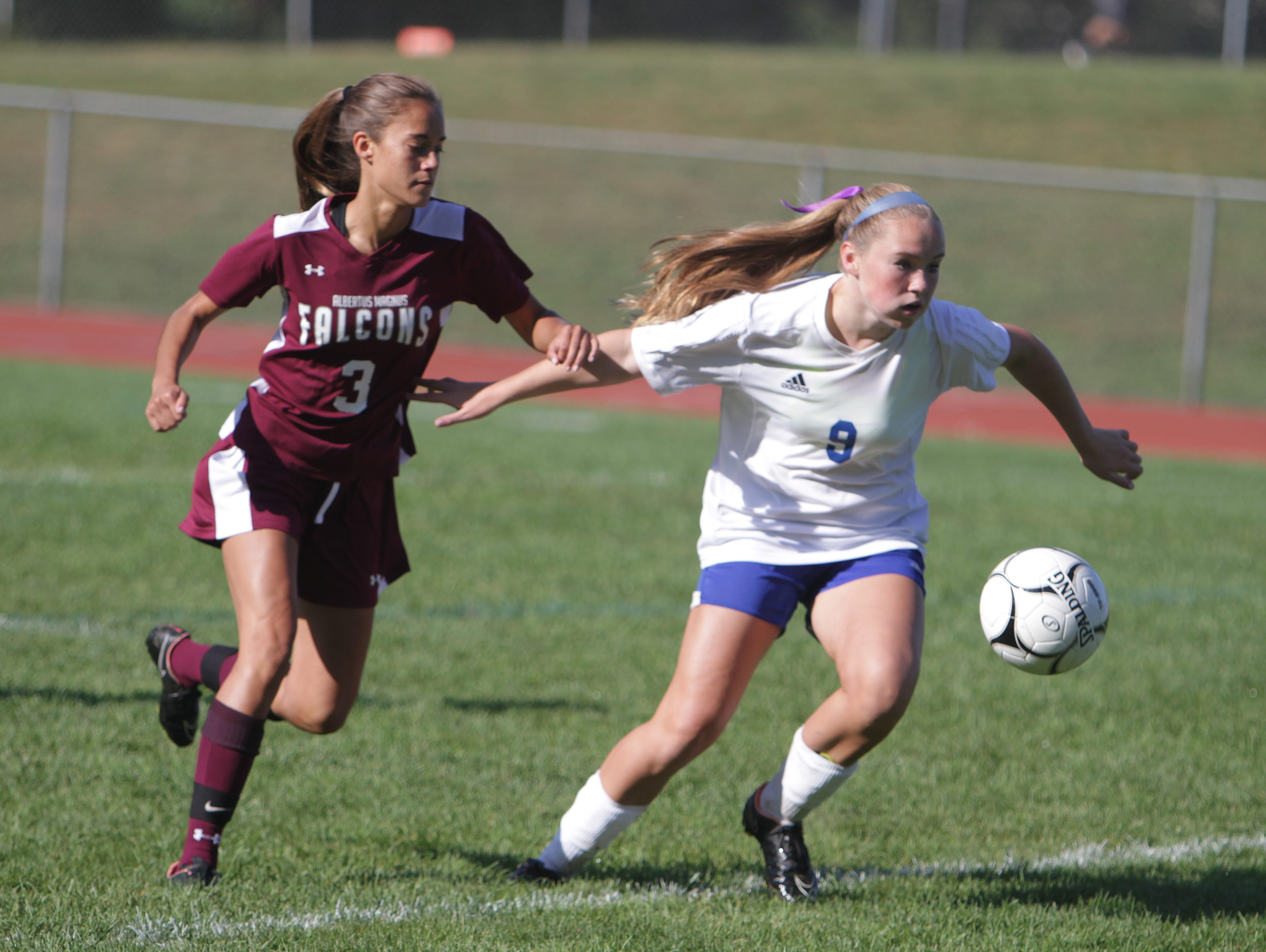 Albertus Magnus' Dani LaRochelle (3) and Pearl River's Julia Pozzuto chase after the ball during a Section 1 girls soccer game between Pearl River and Albertus Magnus at Pearl River High School on Saturday, Sept. 17th, 2016. The teams played to a scoreless draw.