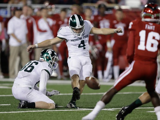 Michigan State's Michael Geiger (4) misses a field goal attempt during the first half of an NCAA college football game against Indiana, Saturday, Oct. 1, 2016, in Bloomington, Ind. (AP Photo/Darron Cummings)