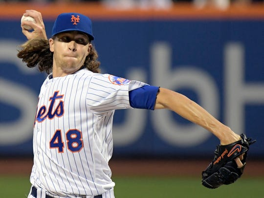 New York Mets pitcher Jacob deGrom delivers the ball