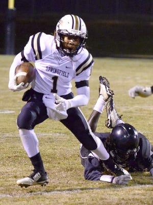 Springfield's Talarico Cogshell eludes a Kenwood tackler.
