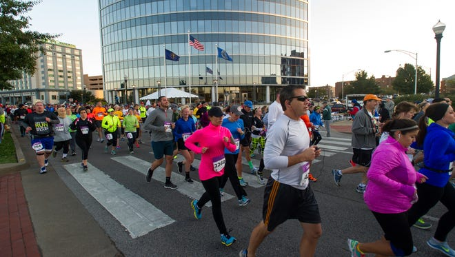 DANIEL R. PATMORE / SPECIAL TO THE COURIER & PRESSRunner start in the eleventh annual YMCA's Evansville Half Marathon Saturday morning Oct. 4, 2014 on the riverfront in downtown Evansville, Indiana.