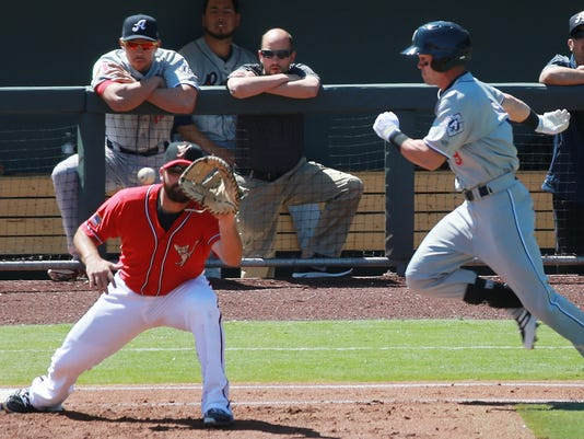 Chihuahuas first baseman Cody Decker reaches for a throw to put out Reno's Evan Marzilli on Tuesday.