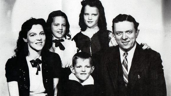 """Reader Arlamae Bolton shared this photo, on the back of which was written """"Happy Johnny and Family."""""""