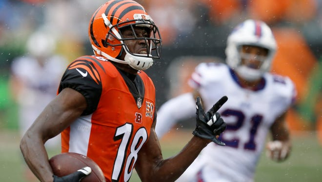 Cincinnati Bengals wide receiver A.J. Green (18) breaks away after an over the shoulder catch for a 61-yard touchdown in the first quarter of the NFL Week 5 game between the Cincinnati Bengals and the Buffalo Bills at Paul Brown Stadium in downtown Cincinnati on Sunday, Oct. 8, 2017.