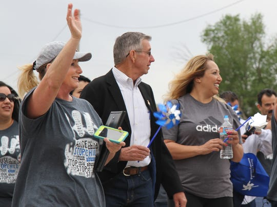 Carlsbad Mayor Dale Janway walks along Canal Street in Carlsbad during the annual Walk Against Child Abuse.