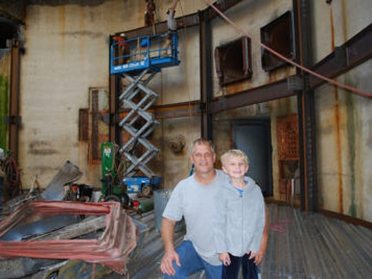 Larry Hall, formerly of Brevard County, with his then 7 year old son, as the first Survival Condo was under construction outside Concordia, Kansas.