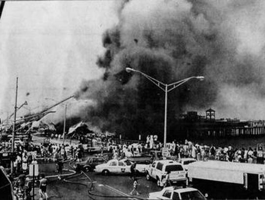 The Long Branch pier burns down in this picture from
