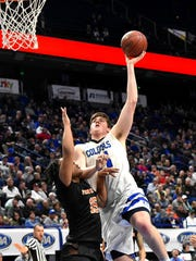 """Jake Walter drops in a skyhook for Covington Catholic, at the KHSAA Basktball Tournament """"Elite Eight"""", Lexington, KY, March 16, 2018."""