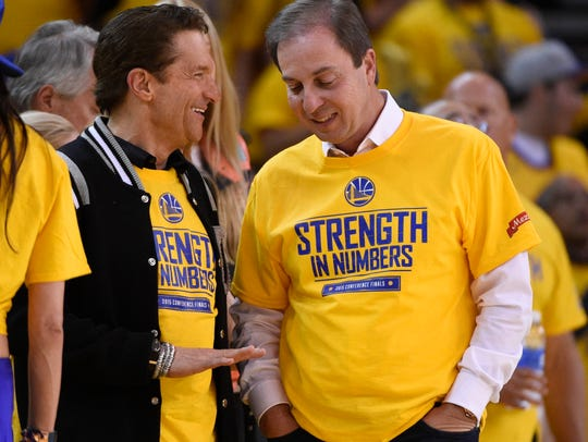 Golden State Warriors co-owners Peter Guber (left)