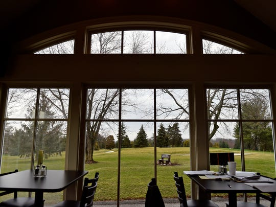 Part of the Grandview Golf Course can be seen from the cafe area inside the clubhouse.