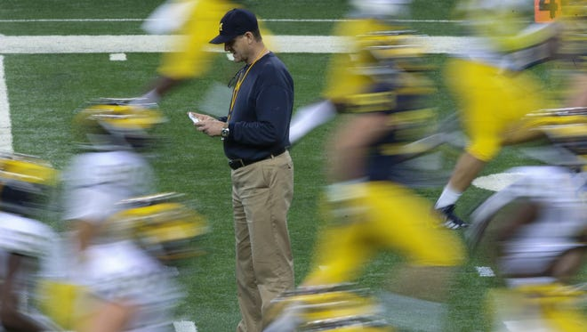 """""""Sometimes spring practice can get monotonous,"""" Jim Harbaugh said after practice at Ford Field in Detroit on Saturday, March 26, 2016."""